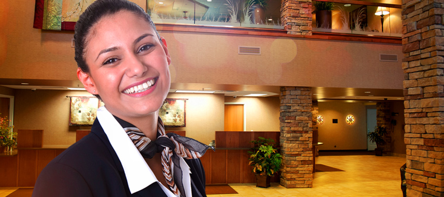 A happy employee standing in the lobby at Prairie's Edge Resort.